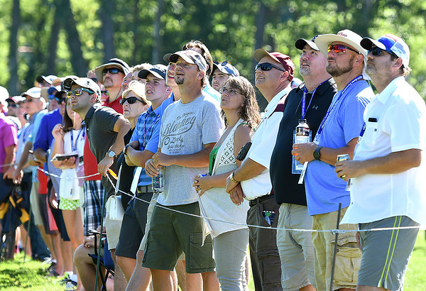 Spectators watching play from the par 4, 16th hole during A Military Tribute at The Greenbrier golf tournament held at The Greenbrier Resort in White Sulphur Springs.<br /> (Rick Barbero/The Register-Herald)