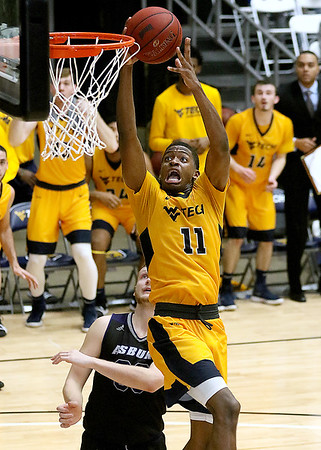 (Brad Davis/The Register-Herald) WVU Tech's Tommy Collins drives and scores during a comeback victory over Asbury Wednesday night at the Beckley-Raleigh County Convention Center.