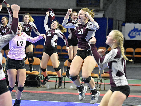 (Brad Davis/The Register-Herald) Woodrow Wilson players erupt into celebration after completing back-to-back comeback set wins to take the match against University during State Volleyball Tournament action Friday evening at the Charleston Civic Center.