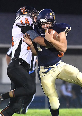 Christian Pack, left, of Summers Co., tackles John Parks of Greenbrier West during first half action at Greenbrier West High School.<br /> Rick Barbero/The Register-Herald)
