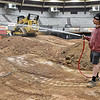 (Brad Davis/The Register-Herald) Chief track builder Donnie Freeman begins to water down the nearly-completed course as he and others prepare a moto-cross dirt track inside the Beckley-Raleigh County Convention Center in preparation for the Tristate MX Indoor Championship Series Thursday afternoon. Running tonight and Saturday at 7:00 p.m., the two-night dirt bike racing event is open to area participants of all ages and classes including beginner and youth, with proper gear and their own dirtbikes required. Sign-ups will begin today at the Convention Center at 10:00 a.m. and on Saturday at 9:00 a.m. This will be the first of four events for the Huntington-based series, which will travel to Lexington, Kentucky for their next event two weeks after this. Potential riders will be checked for safe equipment and asked to sign waivers.