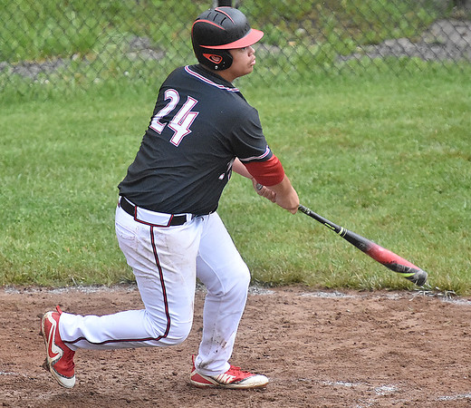 (Brad Davis/The Register-Herald) Greater Beckley Christian slugger Reece Standard watches the ball sail to dead center as he cranks the first of two home runs on the day against Charleston Catholic Tuesday evening.