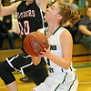 (Brad Davis/The Register-Herald) Wyoming East's Kara Sandy pump fakes on a drive to the basket as PikeView's Hope Craft sails past her Thursday night in New Richmond.