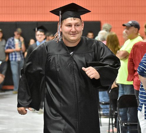 (Brad Davis/The Register-Herald) Graduating Summers County senior Brandon Maddy walks proudly down the aisle as his class makes their way into the gym during the opening moments of the school's 2018 Commencement Ceremony Friday evening in Hinton.