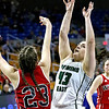 (Brad Davis/The Register-Herald) Wyoming East's Allie Lusk drives to the basket as Wayne's Maddie Wilcox defends Friday morning at the Charleston Civic Center.