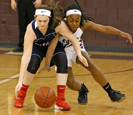 (Brad Davis/The Register-Herald) Woodrow Wilson's Sydni Darden rushes in to steal the ball from Independence's Madison Deck during the Lady Eagles' win on Hall of Fame Friday night.