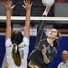 (Brad Davis/The Register-Herald) Independence's Mykal Daniel spikes the ball as Oak Glen's Jaedyn Hissam tries to block it during State Volleyball Tournament action Friday morning at the Charleston Civic Center.