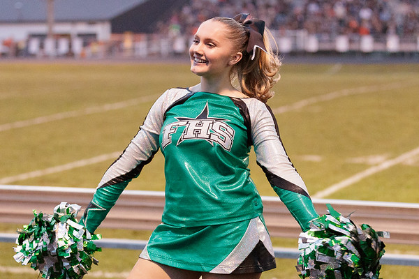A Fayetteville High School cheerleader performs during a time out. Chad Foreman for the Register-Herald.