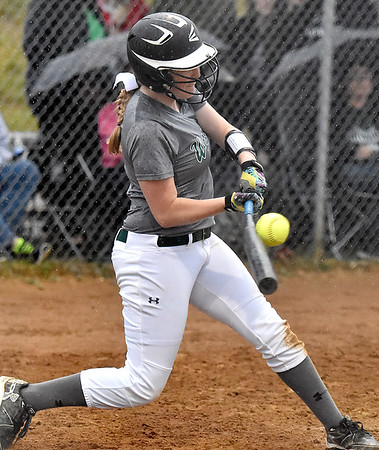(Brad Davis/The Register-Herald) Wyoming East's Lexi Booth makes contact and puts the ball in play during the Warriors 4-3 win over Independence Friday evening at Liberty High School.