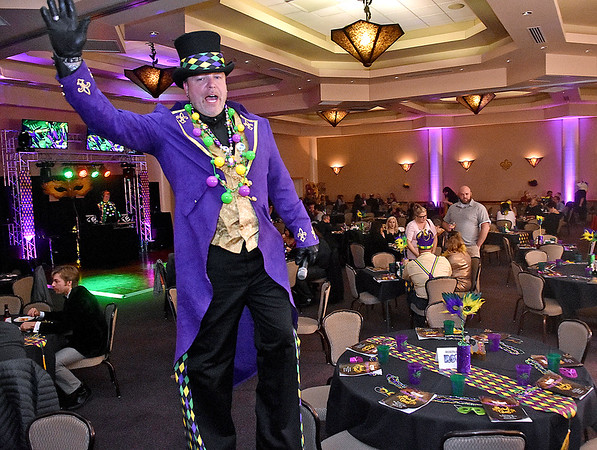 (Brad Davis/The Register-Herald) A very tall DJ Thunder, a.k.a. Neil White, patrols the room interacting with patrons during the Mardi Gras-themed annual Fur Ball event Saturday night at Tamarack.