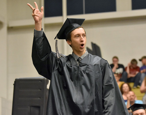 (Brad Davis/The Register-Herald) Graduating Westside senior Johnny Hatfield waves to the crowd as he's called to receive his diploma during the school's 2018 Commencement Ceremony Sunday afternoon in Clear Fork.