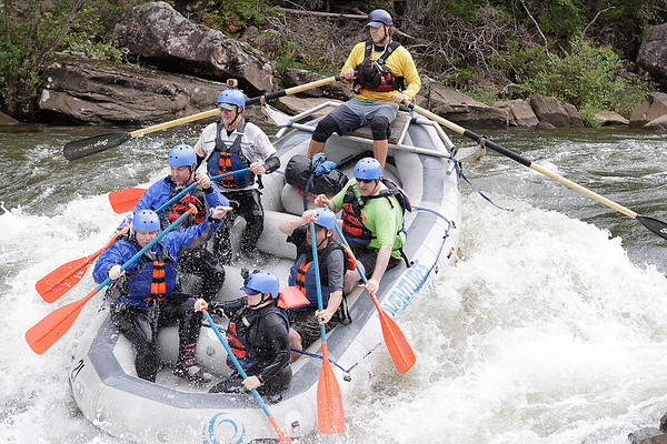 Doug Ludwig, raft guide for Adventures On The Gorge, uses oars to help guide his raft through the Hawaii-5-0 Wave in the second drop of Lost Paddle, a Class V rapid on the Upper Gauley River. Chad Foreman for the Register-Herald.