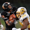 Summers County's Christian Pack (14) is hit by Mount View's Elijah Barner (30) <br /> during their high school football game Thursday in Hinton. (Chris Jackson/The Register-Herald)