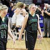 (Brad Davis/The Register-Herald) Wyoming East senior Misa Quesenberry (#12) and junior Jazz Blankenship try to hold back tears as they exit the court with the North Marion Lady Huskies celebrating their Class AA State Championship victory behind them Saturday afternoon at the Charleston Civic Center.