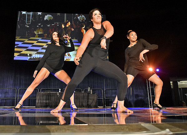 (Brad Davis/The Register-Herald) Dance choreographers perform during the United Way of Southern West Virginia's Dancing With the Stars fundraising event Friday night at the Beckley-Raleigh County Convention Center.