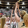(Brad Davis/The Register-Herald) Wyoming East celebrates with the trophy during Big Atlantic Classic action Saturday the Beckley-Raleigh County Convention Center.