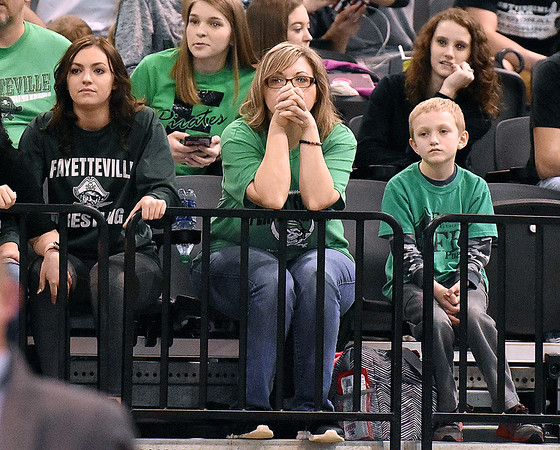 (Brad Davis/The Register-Herald) Invested Fayetteville fans and family watch as their wrestler Trent Pullens takes on Independence's Connor Gibson during State Wrestling Tournament action Saturday night at the Big Sandy Arena.