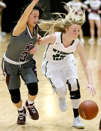 (Brad Davis/The Register-Herald) Wyoming East's Gabby Lupardus holds off George Washington defender Vivian Ho as she charges up the court Big Atlantic Classic action Saturday the Beckley-Raleigh County Convention Center.