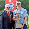 (Brad Davis/The Register-Herald) David Bradshaw poses receives the trophy after winning the 2018 West Virginia Open Friday afternoon at Glade Springs' Cobb Course.