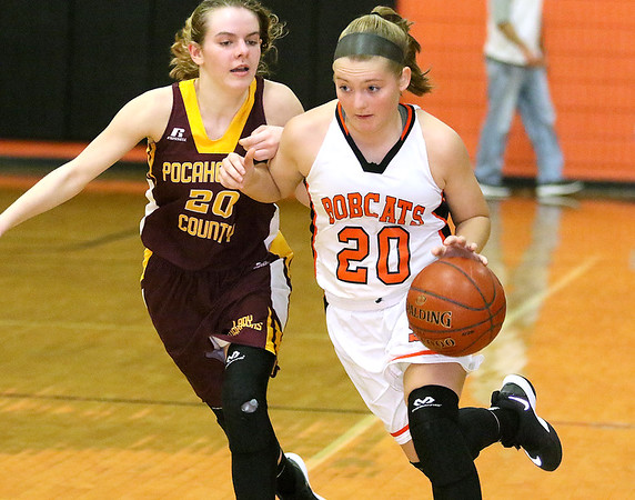 (Brad Davis/The Register-Herald) Summers County's Tiffani Cline charges around Pocahontas County's Kira Bircher as she moves the ball across mid court Wednesday night in Hinton.
