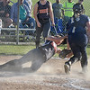 (Brad Davis/The Register-Herald) Summers County's Jaiden Dickenson is tagged out at the plate by Greenbrier West catcher Katlyn Gray as she makes a hard slide to try and avoid it Wednesday evening at Western Greenbrier Middle School.