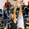(Brad Davis/The Register-Herald) Westside's Shane Jenkins drives and scores as Shady Spring's Cole Honaker defends Wednesday night in Shady Spring.