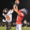 (Brad Davis/The Register-Herald) Summers County's defensive back Sam Wykle breaks up a pass attempt to Indy receiver Derek Farley Friday night in Coal City.