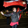 An Oak Hill Flag Corps member flies her school colors with pride. Chad Foreman for the Register-Herald.