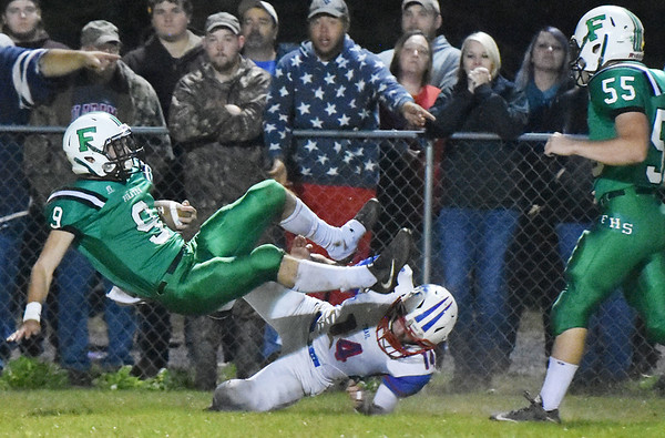 Fayetteville's Jordan Dempsey is tackled in the endzone after a long carry by Midland Trail's Trevor Maichle (14) during their high school football game Friday in Fayetteville. (Chris Jackson/The Register-Herald)