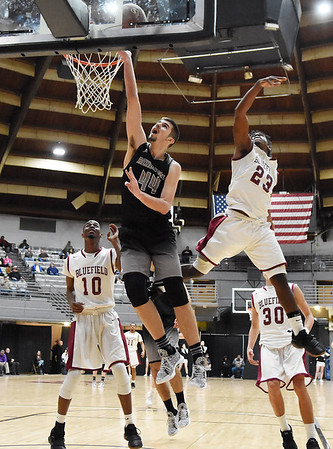 Westside's Corey Hatfield (44) lays a basket in over Bluefield's (25) Russ Coleman late in the fourth quarter of their Big Atlantic Classic Tournament game Tuesday in Beckley. (Chris Jackson/The Register-Herald)