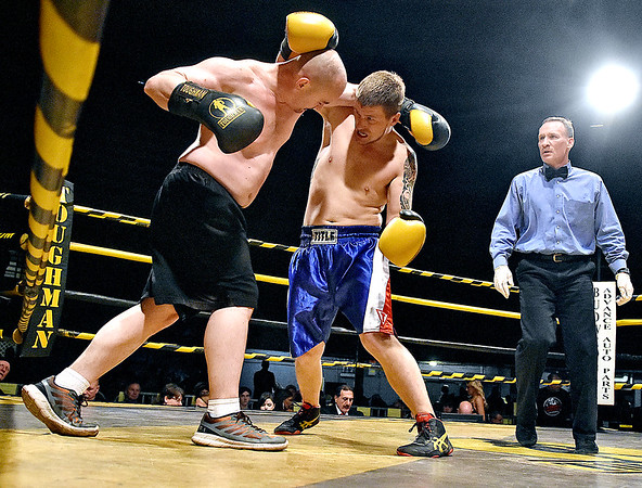 "(Brad Davis/The Register-Herald) Chris Stephens, right, battles opponent Terry Styer during their match in the ""Original"" Toughman Contest Saturday night at the Beckley-Raleigh County Convention Center."