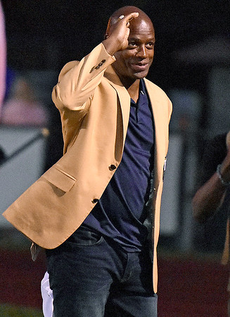 (Brad Davis/The Register-Herald) NFL Hall of Famer Darrell Green acknowledges the crowd at Van Meter Stadium after being introduced during a break in the action Friday night in Beckley.