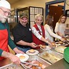 Jim McDowell, left, Darrell Holoway, Barbara Holoway, Mallory Daniel and Ava Mullins, serving food during the Community Christmas Dinner held at The Place in Beckley Monday afternoon.<br /> (Rick Barbero/The Register-Herald)