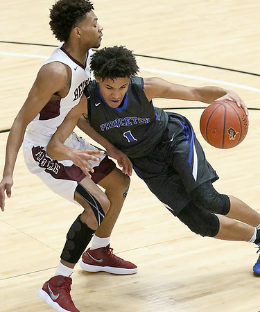 (Brad Davis/The Register-Herald) Princeton's Chiron Cannady puts a shoulder into Woodrow Wilson's Mikey Penn as he drives to the basket during the Sectional Championship Friday night at the Beckley-Raleigh County Convention Center.