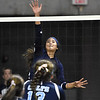 (Brad Davis/The Register-Herald) Shady Spring's Sandy Mills hits the ball bnack over against Philip Barbour during State Volleyball Tournament action Friday evening at the Charleston Civic Center.