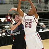 (Brad Davis/The Register-Herald) Bluefield's Russ Coleman drives and scores as James Monroe's Monroe Mohler defends during Big Atlantic Classic action Thursday night at the Beckley-Raleigh County Convention Center.