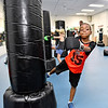 (Brad Davis/The Register-Herald) Seven-year-old Mehki Edwards, near, and six-year-old Sophie Phillips, behind Edwards, work on roundhouse kicks during the first Kids Combat Cardio session to be held Sunday afternoon at the YMCA of Southern West Virginia. The one hour class will be held every Sunday in two age groups, kids 5-10 at 3:00 p.m., kids 11-18 at 4:00 p.m. and combines a fun workout environment with basic mixed martial arts training and techniques.