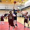 (Brad Davis/The Register-Herald) WV Thunder's (Huntington) Addyson Cornell pulls up for a jump shot in the paint as Beckley White's Allen Hughes (#12) and Harmony Mills (#11) defend during a fourth grade Biddy Buddy Tournament game Friday afternoon at the YMCA of Southern West Virginia. WV Thunder won the game by a wide margin.