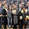 (Brad Davis/The Register-Herald) Shady Spring High School Principal Deanna Massey holds the hardware as her students stand behind her for photos after being awarded the Jennings Randolph Award for registering 100% of their eligible students to vote following a ceremony with state and local officials Friday afternoon. Third from right is Ida Crawford, who has voted in the last 60 election cycles and is in the West Virginia voters hall of fame.