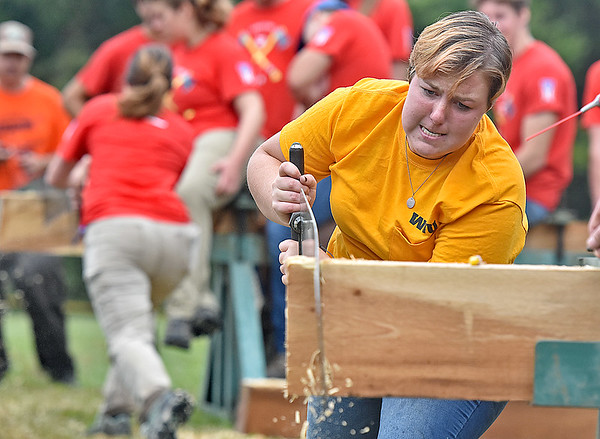 (Brad Davis/The Register-Herald) WVU Woodsman Team member Asthon Stevenson, right, competes one-on-one against Ohio State's Forestry Forum team member Katie Reiderman (background left) during the Lumberjack Competition at the annual Lumberjackin' Bluegrassin' Jamboree Saturday morning at Twin Falls State Park.