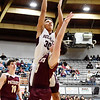 Woodrow Wilson's Eddie Christian (30) attempts a shot over George Washington's Alex Cook (10) during the first quarter of their high school basketball game Tuesday in Beckley. (Chris Jackson/The Register-Herald)