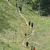 (Brad Davis/The Register-Herald) Spartan racers progress down a steep incline section of the course during the 2nd Annual Spartan Race event Saturday afternoon at the Summit.