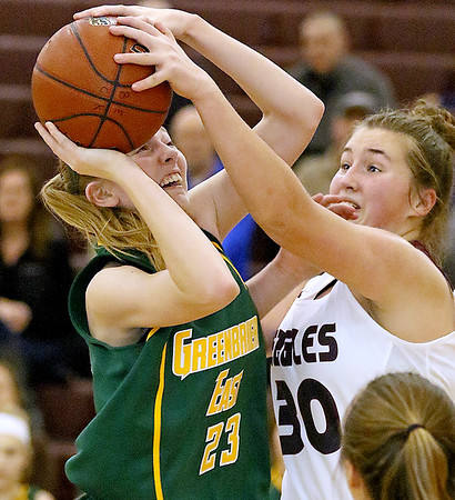 (Brad Davis/The Register-Herald) Greenbrier East's Haley McClure drives to the basket as Woodrow Wilson defender Laken Ball gets a hand on the ball during the Lady Spartans' win over the Flying Eagles Thursday night in Beckley.