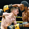 "(Brad Davis/The Register-Herald) Noah Pyatt, left, exchanges haymakers with opponent Charles Moore Jr. during their match in the ""Original"" Toughman Contest Saturday night at the Beckley-Raleigh County Convention Center."