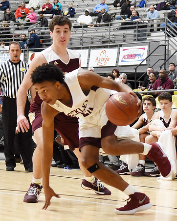 Woodrow Wilson's Mikey Penn (20) gets past George Washington's Alex Cook (10) during the first quarter of their high school basketball game Tuesday in Beckley. (Chris Jackson/The Register-Herald)