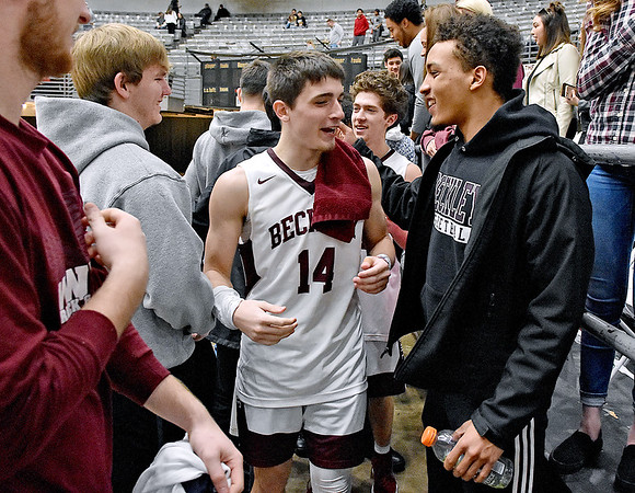 (Brad Davis/The Register-Herald) Woodrow Wilson player Bryce Radford and teammates greet their classmates in the student section following their Sectional Championship win over Princeton Friday night at the Beckley-Raleigh County Convention Center.