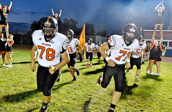 (Brad Davis/The Register-Herald) The Bobcats take the field for their road game at Indy Friday night in Coal City.