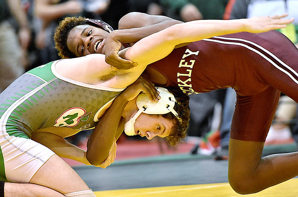 (Brad Davis/The Register-Herald) Woodrow Wilson's Antwon Burnett takes on Musselman's Taven Swick in a 145-pound weight class matchup during state wrestling tournament action Thursday night at Huntington's Big Sandy Arena.