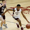 (Brad Davis/The Register-Herald) Woodrow Wilson's Tyriek Walton moves along the perimeter as Virginia Episcopal's Alex Decker defends during the Little General Battle for the Armory Tournament Friday night at the Beckley-Raleigh County Convention Center.