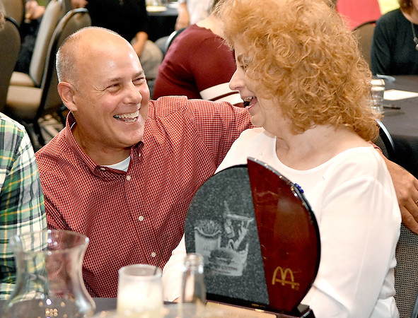 (Brad Davis/The Register-Herald) Co-owner Tim Harper shares a few laughs with longtime, retiring Plaza McDonald's employee Mary Garris after presenting her with an award for service September 15 at Black Knight.